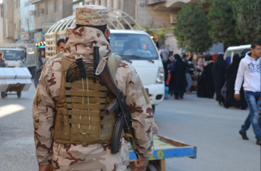 Iraqi soldier in the markets of Karbala https://www.flickr.com/photos/98070911@N05/16446372336/