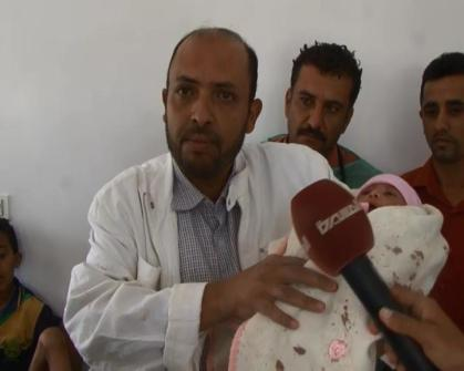 Doctor holds bomb-surviving three-days-old girl in Sanaa, Yemeni capital