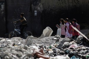 Children taking a walk in destroyed neighborhood of Douma, Damascus