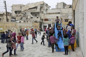 Syrian students playing in the courtyard of their school in rebel-controlled Idlib