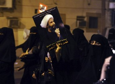 protester-holds-picture-sheikh-nemer-al-nemer-during-rally-coastal-town-qatif-reuters