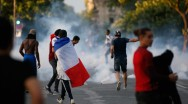 Tear gas floats in the air during clashes near the Paris fans zone during the Portugal v France EURO 2016 final soccer match, at the Eiffel Tower in Paris, France, July 10, 2016. © Stephane Mahe / Reuters