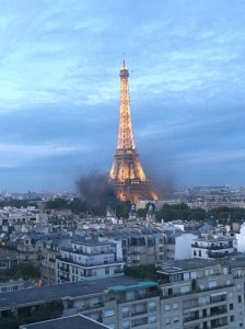 Smoke coming from beneath Eiffel tower in Paris due to clashes between police and protesters